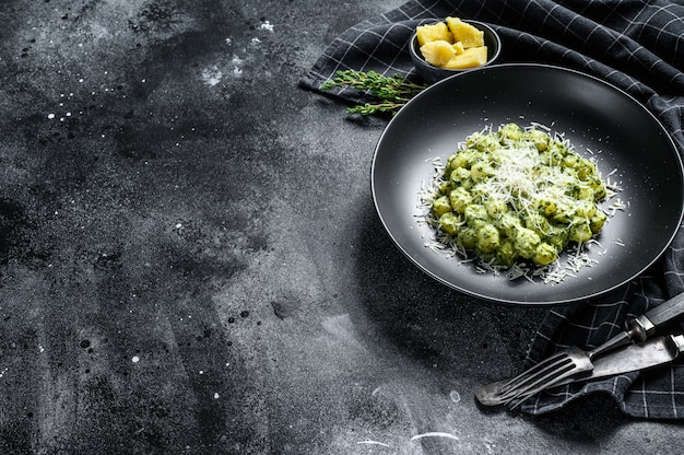 Gnocchi with basil spinach sauce and parmesan. italian potato paste. top view. copy space