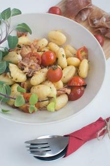 Gnocchi with cherry tomato and prosciutto
