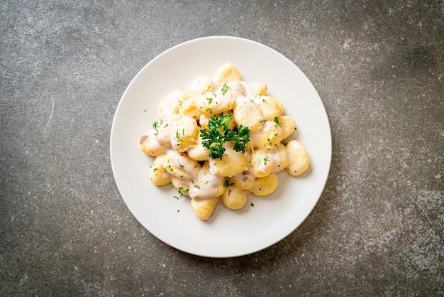 Gnocchi with mushroom cream sauce and cheese