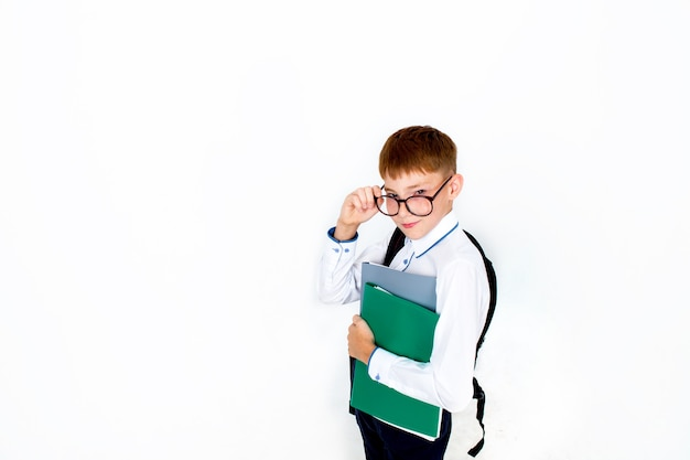 To go back to school. funny boy with glasses, kid from school with a book and a bag