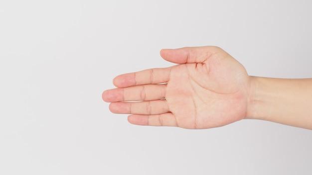 白い背景で隔離のこの方向の手のサインに行きます。 (byを平らに保ち、手のひらを5本の指すべてを使用して特定の方向にサイドポイントに向けます。)
