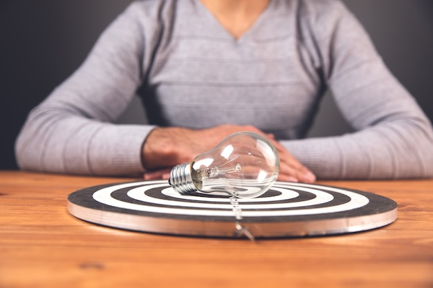 Goal concept, man reaches the goal, on the table, idea, lamp