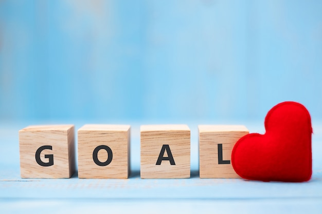 Goal wooden cubes with red heart shape decorationon