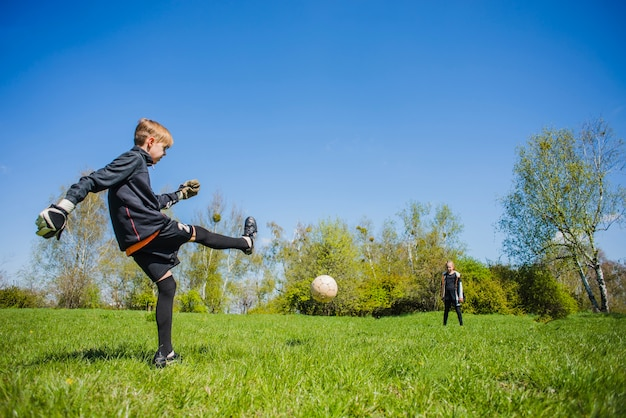 Goalkeeper hitting the ball
