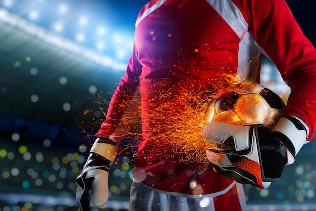 燃えるようなサッカーボールで遊ぶ準備ができているゴールキーパープレーヤー