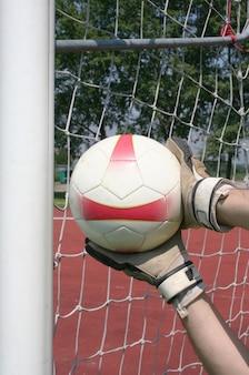 Goalkeeper take the ball