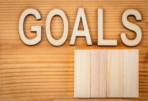 Goals banner - text in vintage letters on wooden blocks.