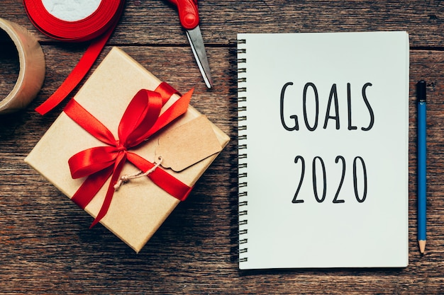 Goals new year 2020 and notepad and gift box