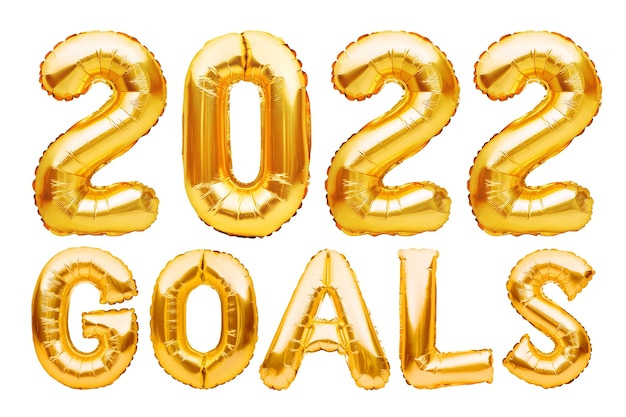 Goals phrase made of golden inflatable balloons new year resolution goal list change and determination concept helium balloons foil letters and numbers celebration decoration