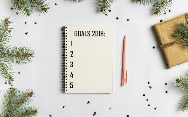 Goals plans dreams make to do list for new year 2018 christmas concept writing
