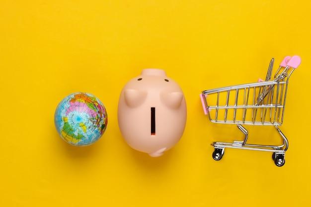 ゴバルスーパー。貯金箱と買い物用トロリー、地球儀は黄色。
