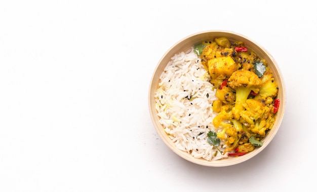 Gobi aloo cauliflower dish with rice in a bowl on white