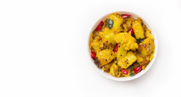 Gobi aloo traditional indian dish of cauliflower and potatoes on white