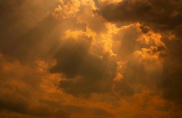 God light. white and golden cloudy sky with sun beam. sun rays through golden clouds. god light from heaven for hope and faithful concept. believe in god. beautiful sunlight sky and fluffy clouds.