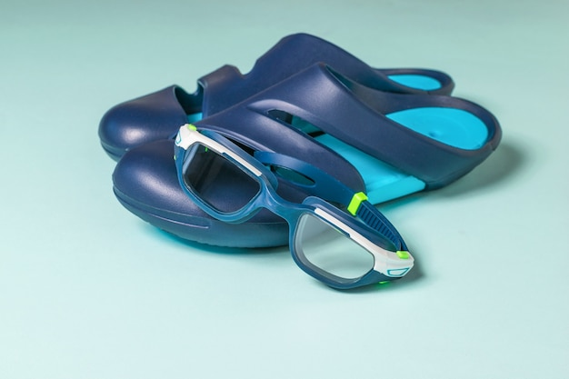 Goggles and flip-flops for the pool. accessories for swimming in the pool.