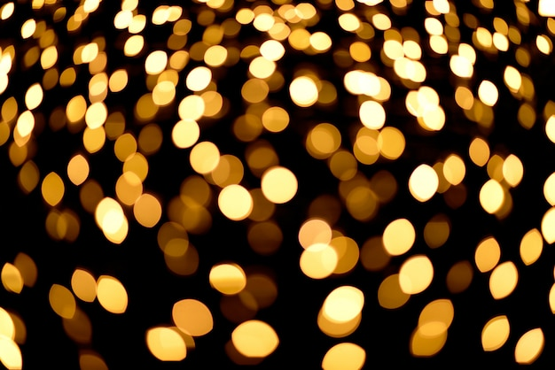 Gold abstract bokeh background.night bokeh christmas lights.