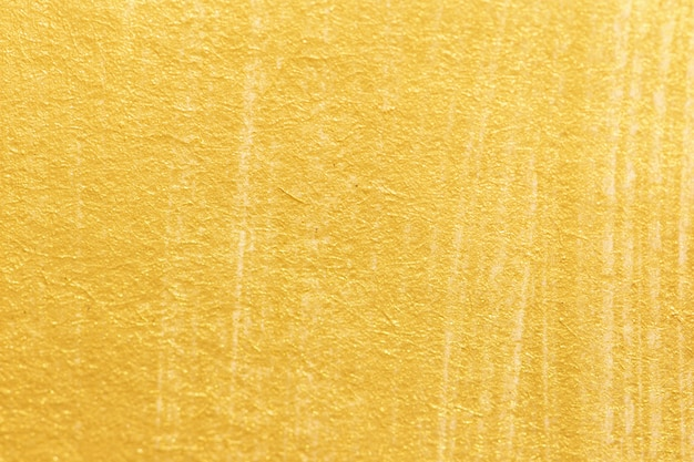 Gold acrylic paint texture on white paper