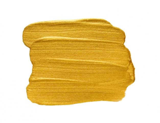 ゴールドのアクリル水彩絵の具ブラシストロークフリーハンド描画テクスチャの白い背景で隔離