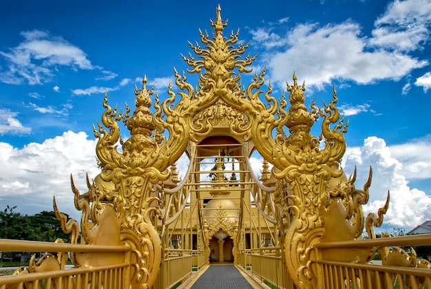The gold architecture in wat rong khun temple (white temple) in chiangrai, thailand