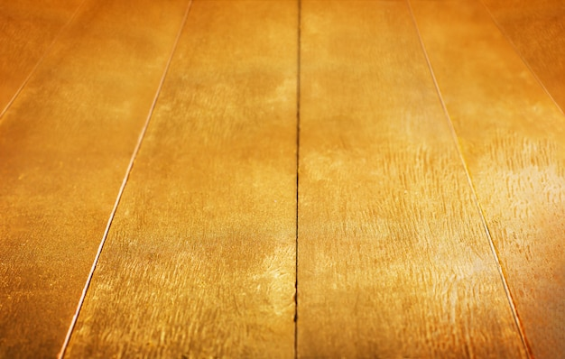 Gold background. golden wooden painted rustic table texture