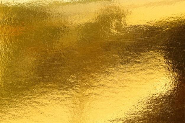 ゴールドの背景またはテクスチャとグラデーションの影