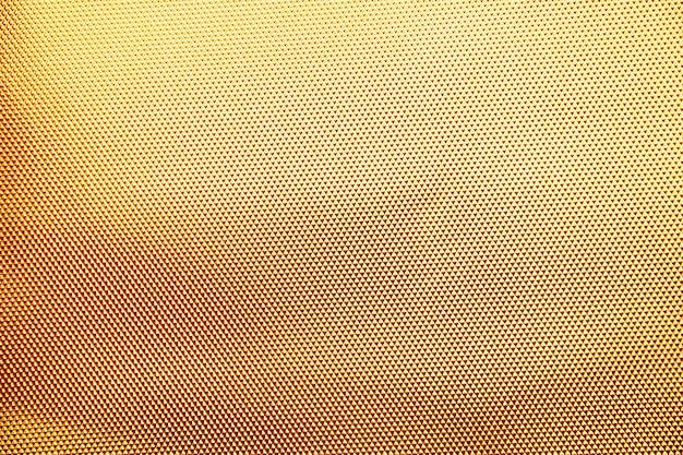 ゴールドの背景またはテクスチャとグラデーションの影。