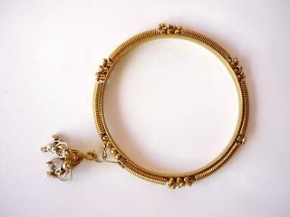 Gold bangles, rounded