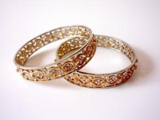Gold bangles, shiny, gems