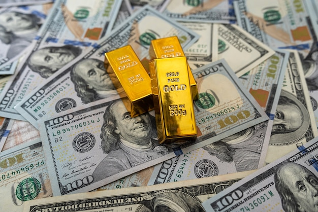 Gold bars on 100 us dollar note