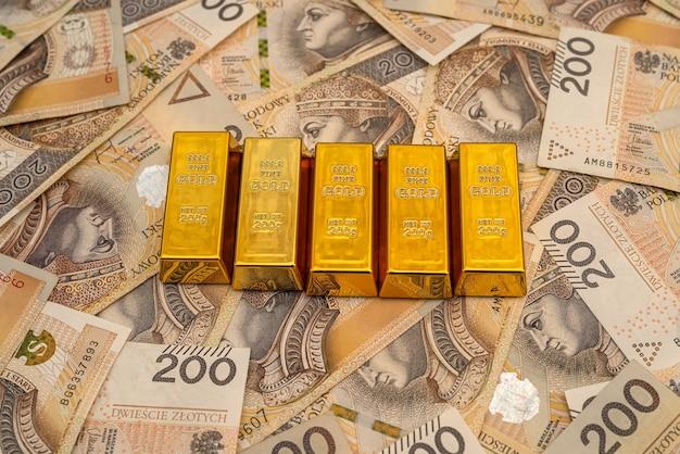 Gold bars on polish money zloty pln. treasure