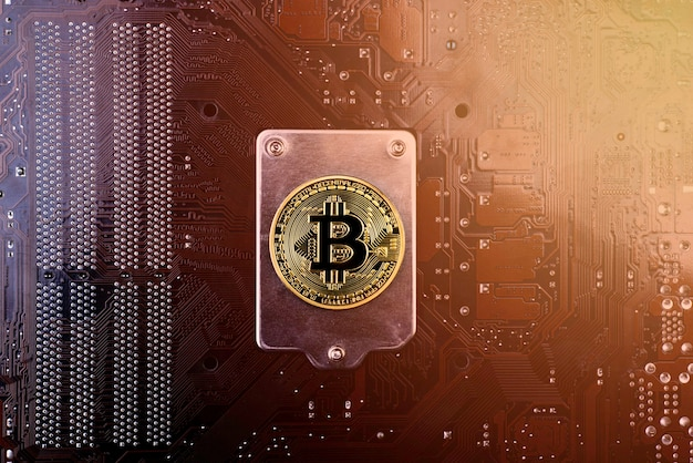 Gold bitcoin on the back of the motherboard