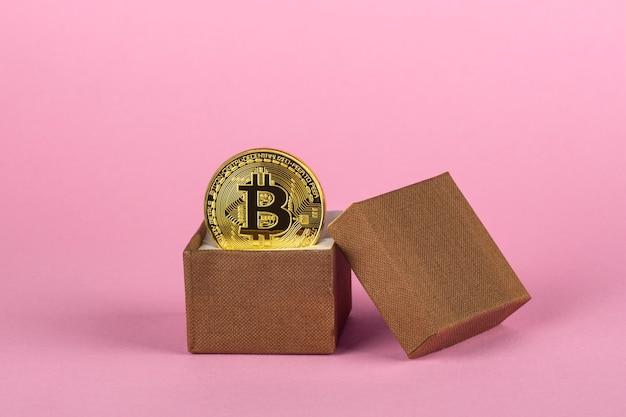 Gold bitcoin in a gift box