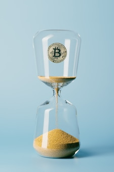 모래시계 안에 있는 금 비트코인. 암호화폐, 돈과 시간