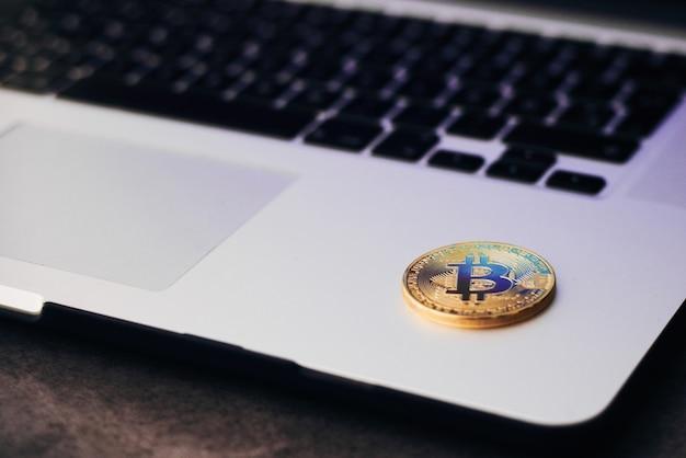 Gold bitcoin on laptop keyboard
