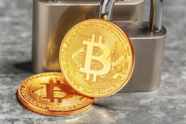 Gold bitcoin and padlock