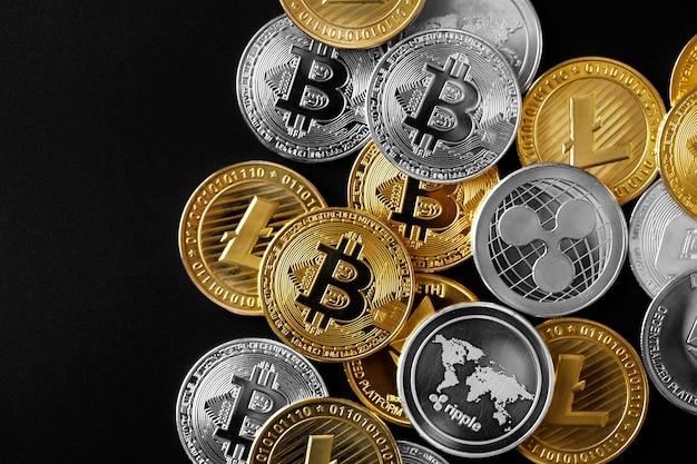 A gold bitcoin sign symbol icon bursting through a the