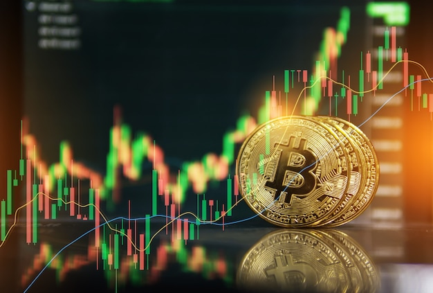 Gold bitcoin with growth graph chart trading view. bitcoin gold coin and defocused chart background. virtual cryptocurrency concept. stock market chart. bitcoin investment business internet technology