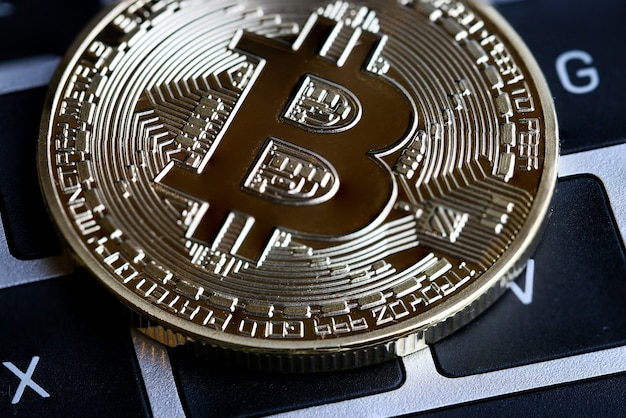 Gold bitcoins circuit with b letter symbol on keyboard.