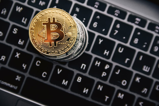 Gold bitcoins on computer keyboard