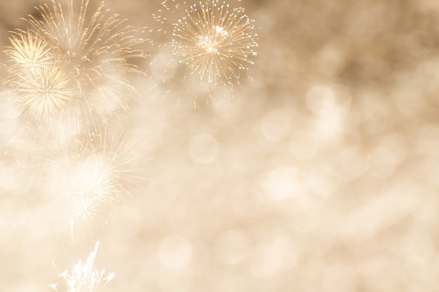 Gold bokeh with firework for new year or celebrate background
