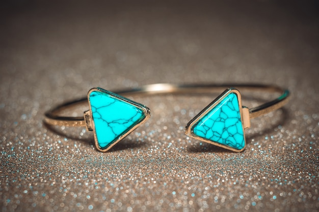 Gold bracelet with blue turquoise