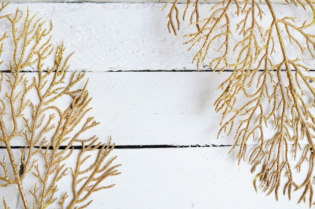 Gold branches, yellow leaves on white wood