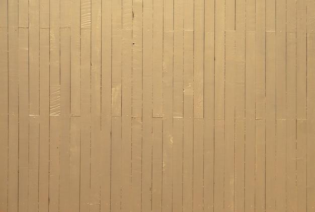 ゴールド、ブラウンの木製パネルテクスチャ背景