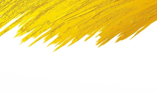 Золотая кисть штрих текстуры на белом фоне