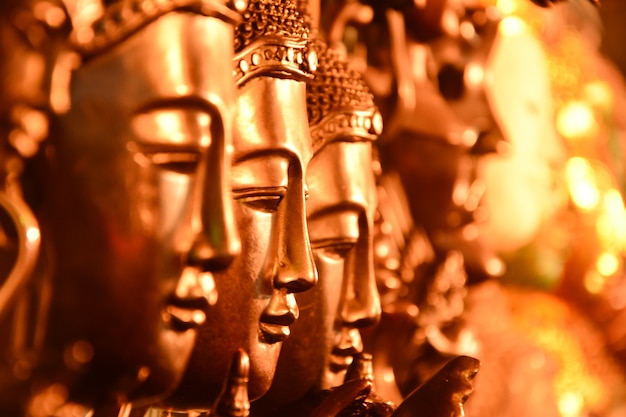 Gold buddha head arranged with selective focus.