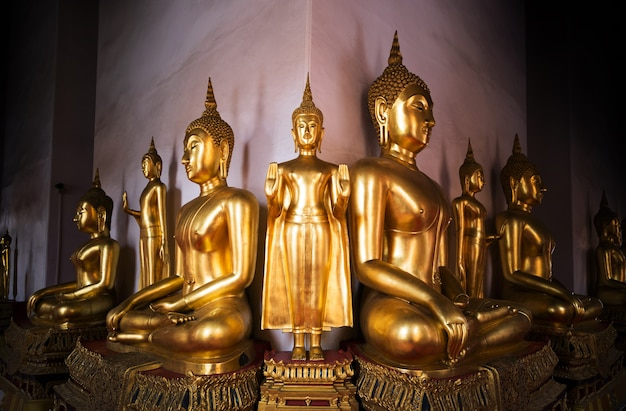 Gold buddha statue in art of  buddhism religion in asia culture at bangkok siam thailand temple