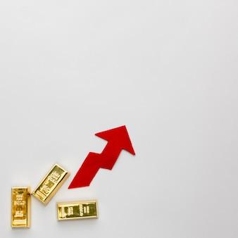 金の地金と上向きの矢印