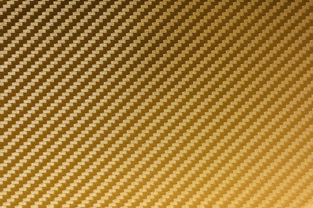 Gold carbon fiber composite raw material background