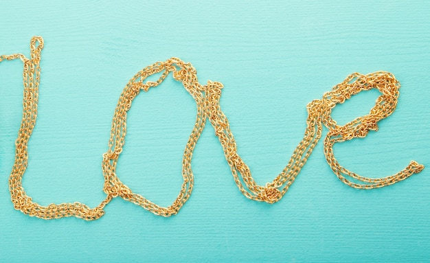 Gold chain. the word love.