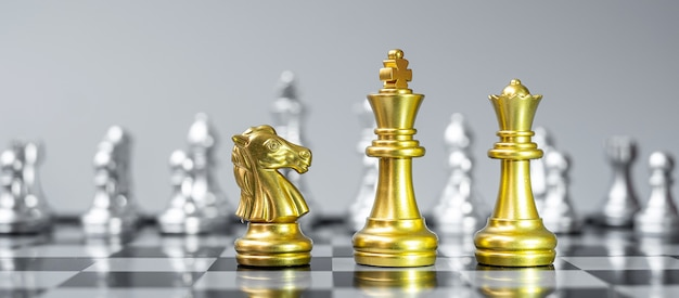 Gold chess figure team on chessboard